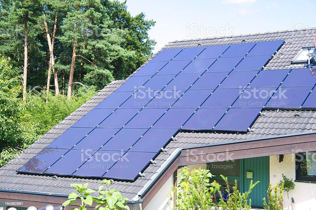 shiny solar panels on roof royalty-free stock photo