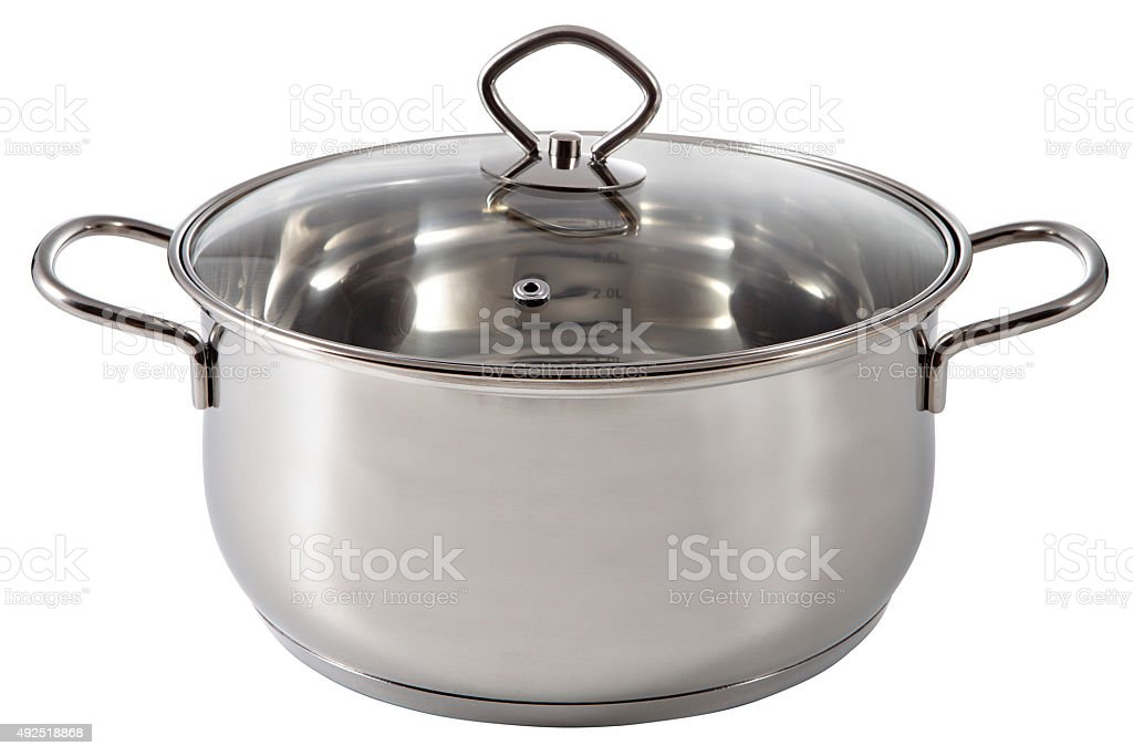 Shiny stainless steel soup pot, covered a lid transparent glass. stock photo