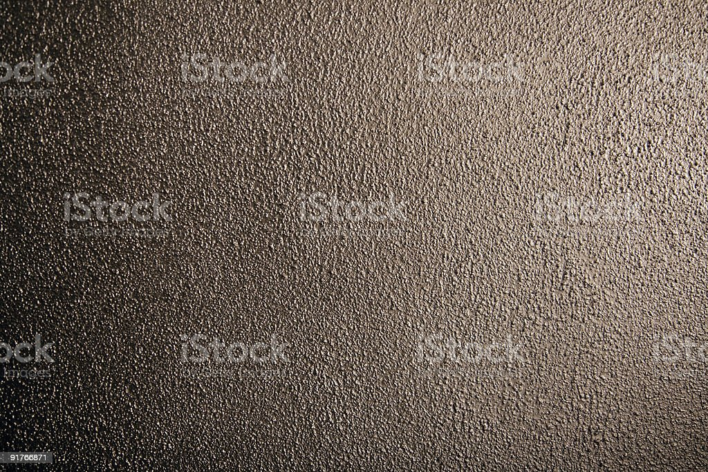 Shiny structured bronze wall royalty-free stock photo