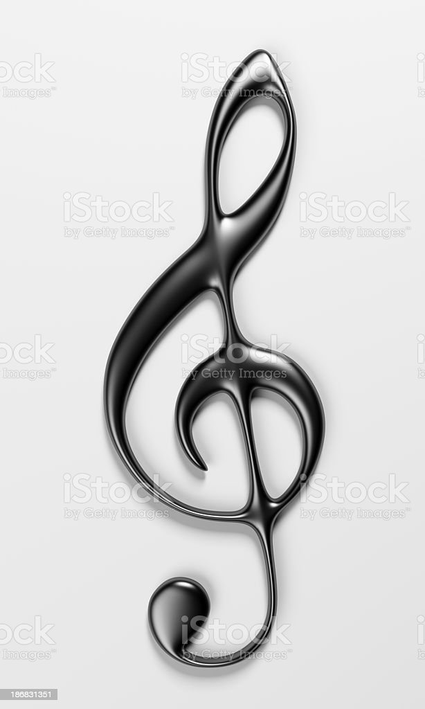A shiny treble clef with shadow on a white background royalty-free stock photo