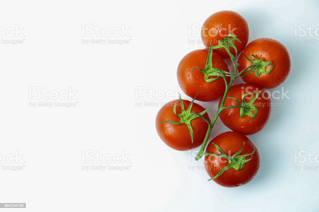 Shiny Truss Tomatoes with Water Drops stock photo