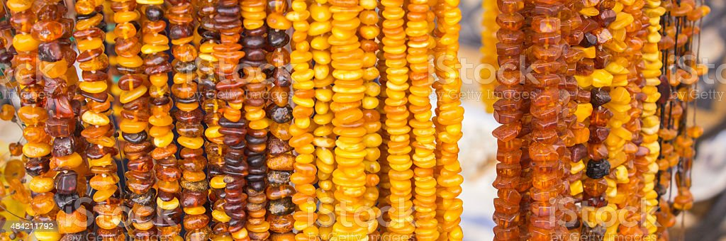 Shiny womanly amber necklaces on stall at the bazaar stock photo