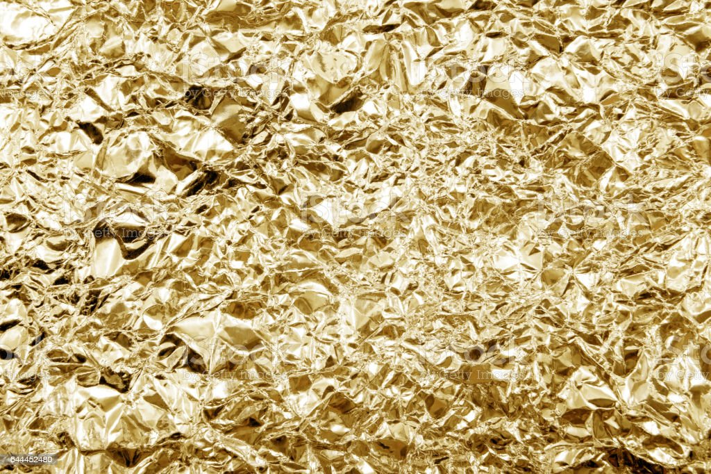 Shiny yellow gold golden color decorative texture paper. stock photo