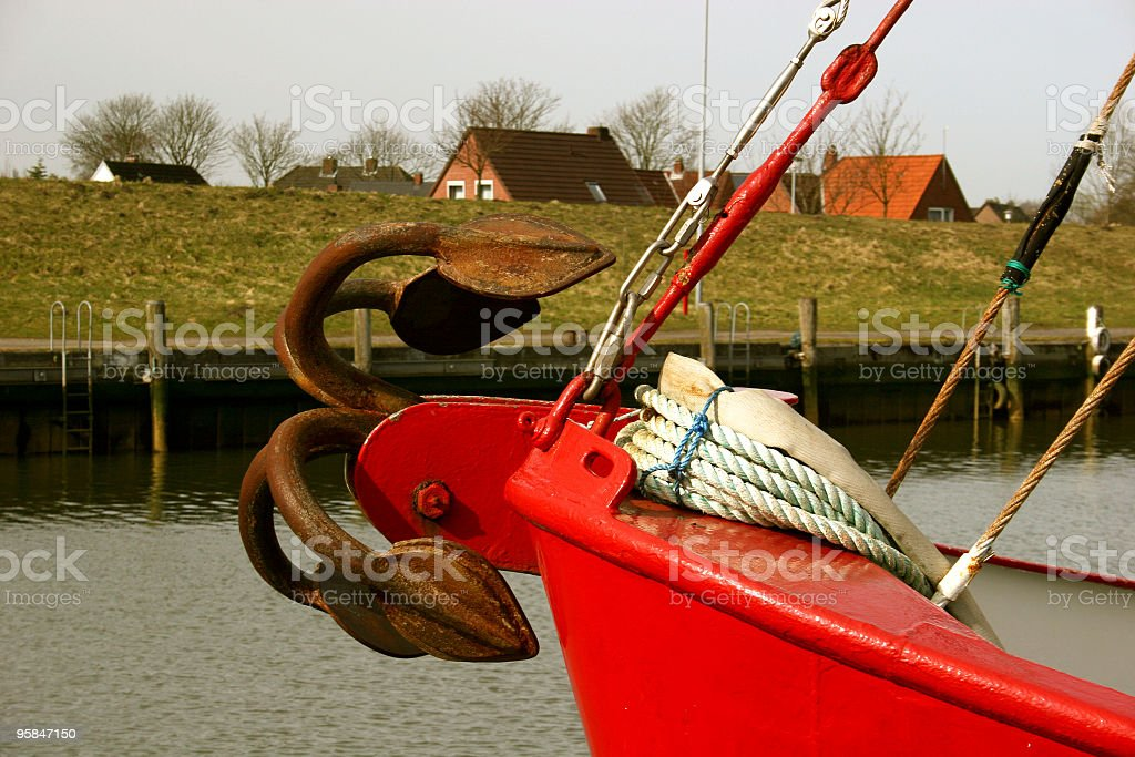 Ship anchor in the harbor of Friedrichskoog royalty-free stock photo