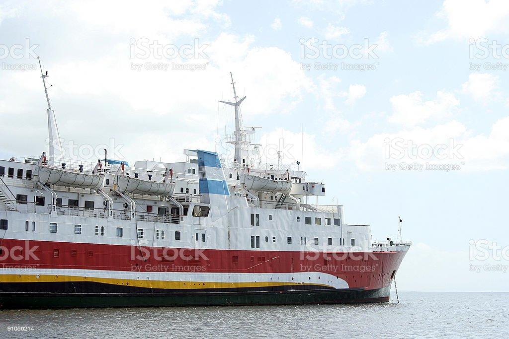 Ship anchored close to the shore royalty-free stock photo