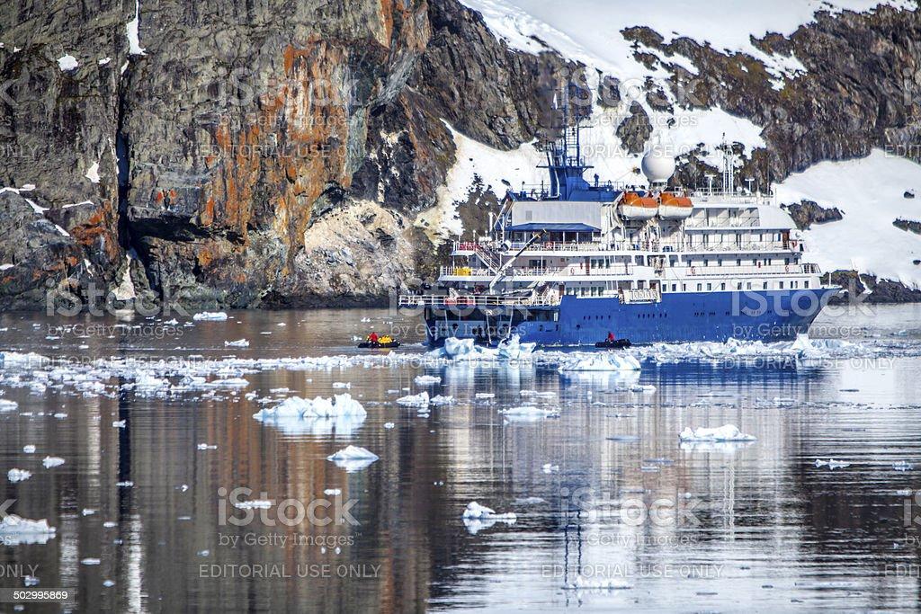 Ship anchored in a bay on the Antarctic Peninsula stock photo