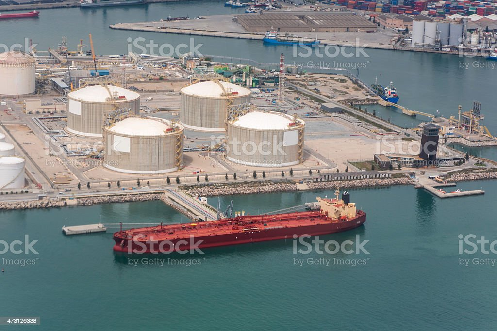 ship and gas tanks at harbour of barcelona spain stock photo