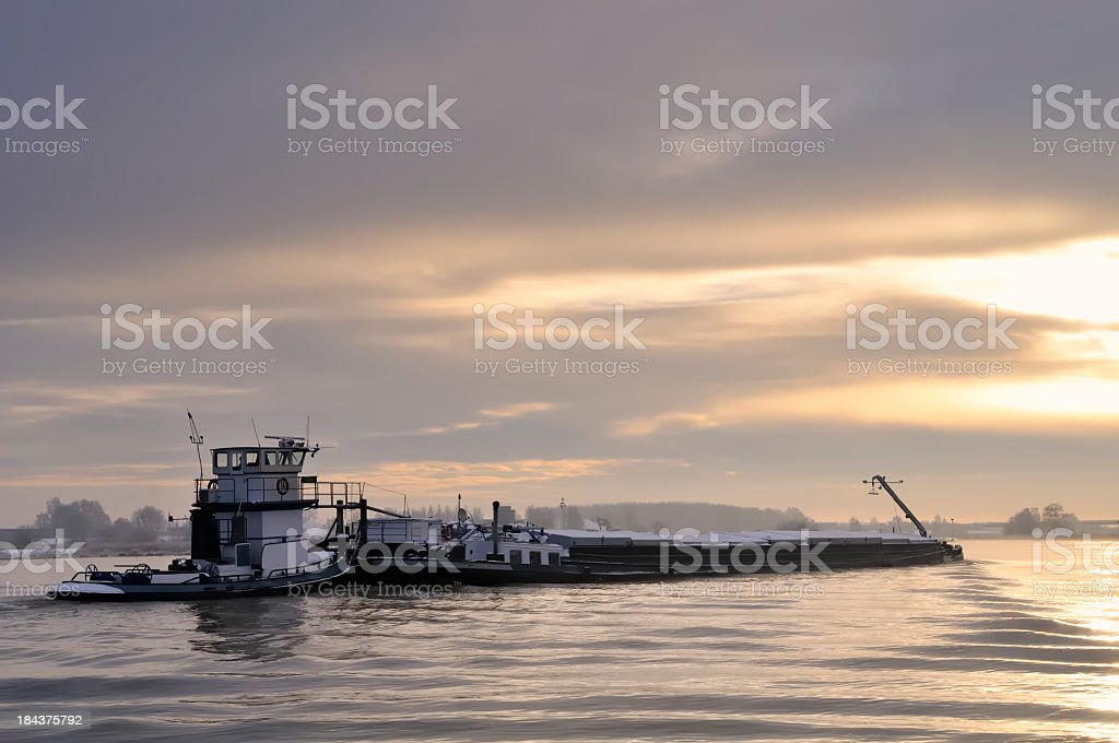 Ship and low sun stock photo