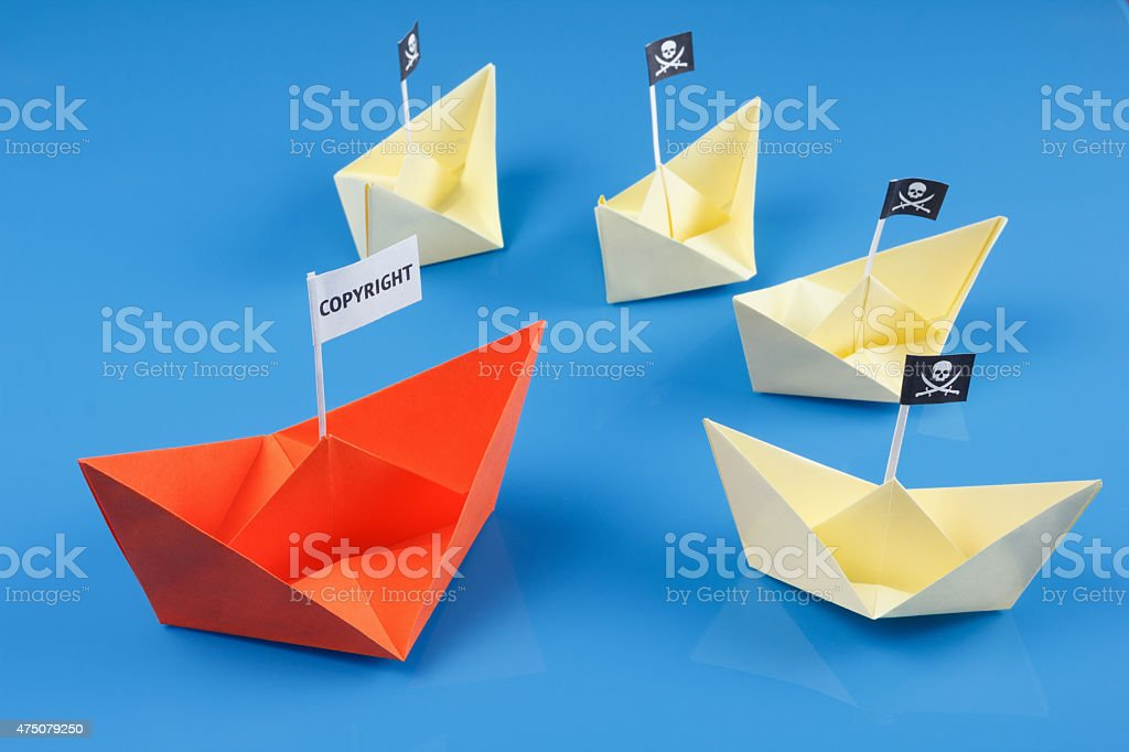 Ship and several pirate boats stock photo