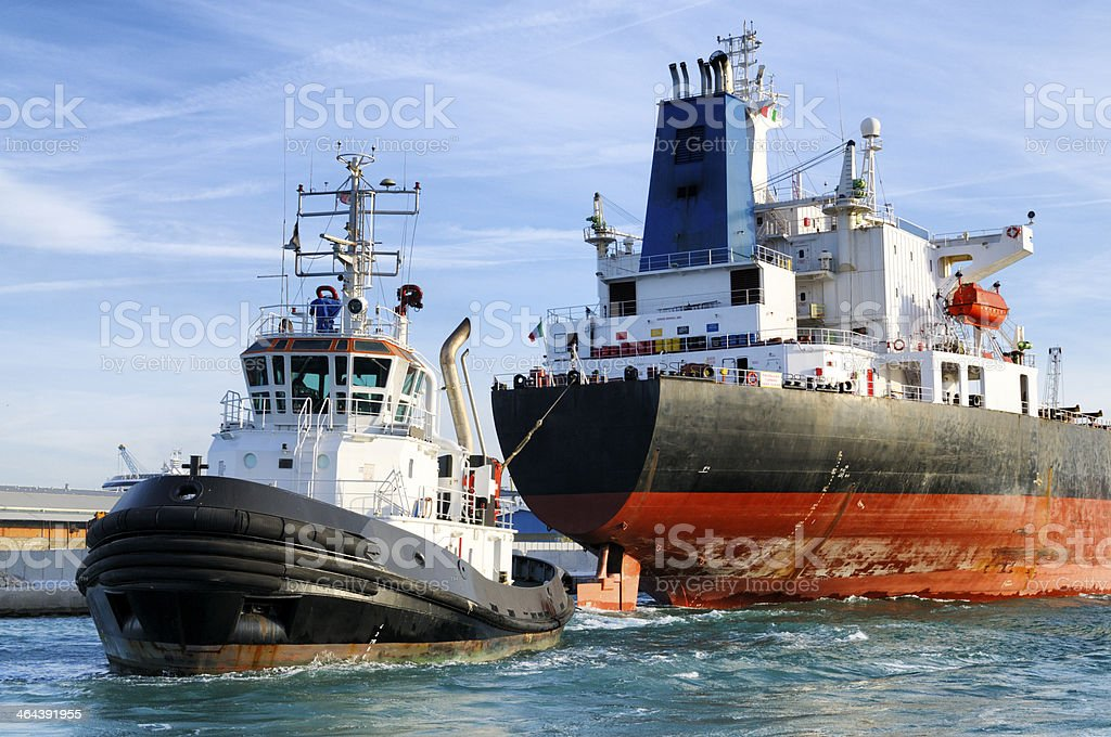 Ship and tugboat stock photo