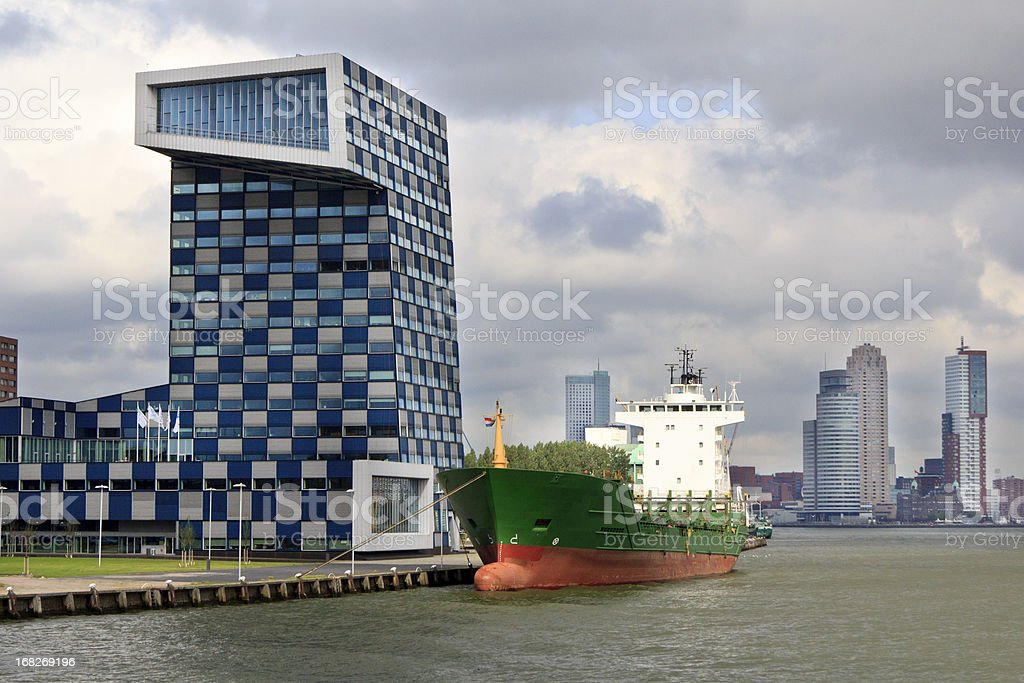 Ship at quayside and cityscape, Rotterdam stock photo