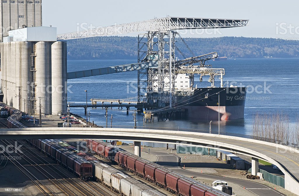 Ship being loaded from grain silos stock photo