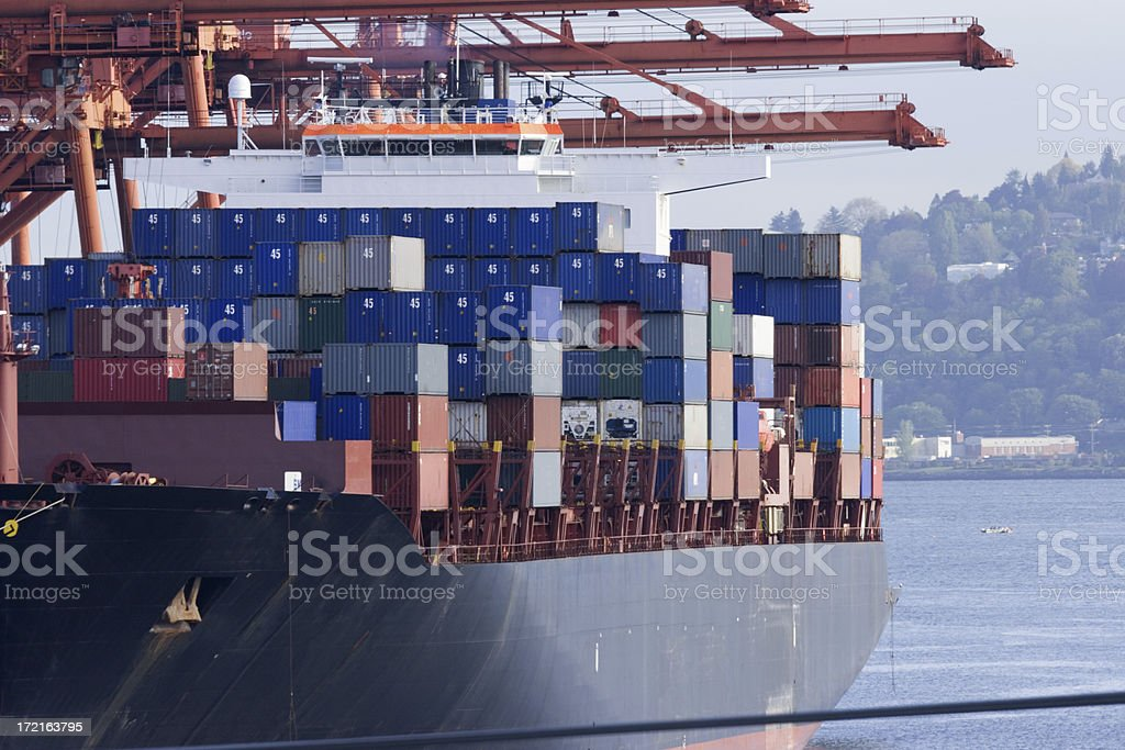 Ship being loaded stock photo