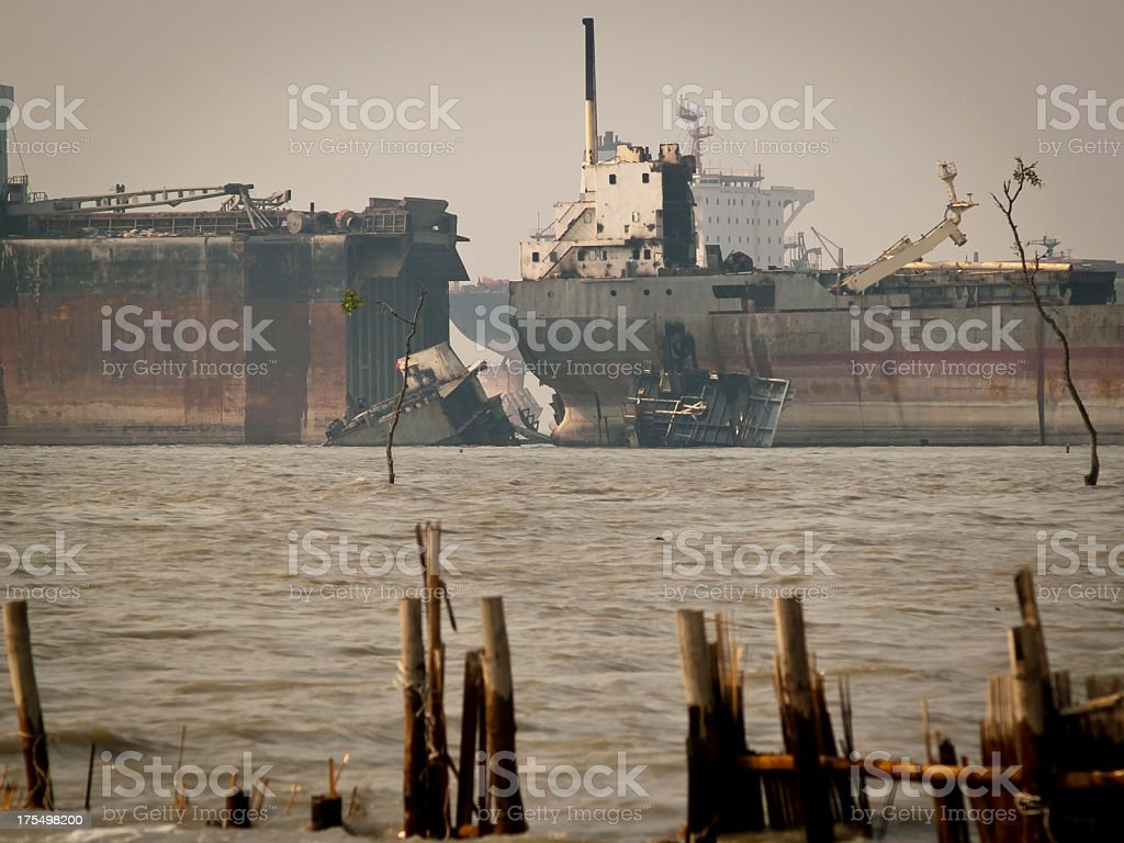 Ship breaking yards through foggy and toxic atmosphere stock photo