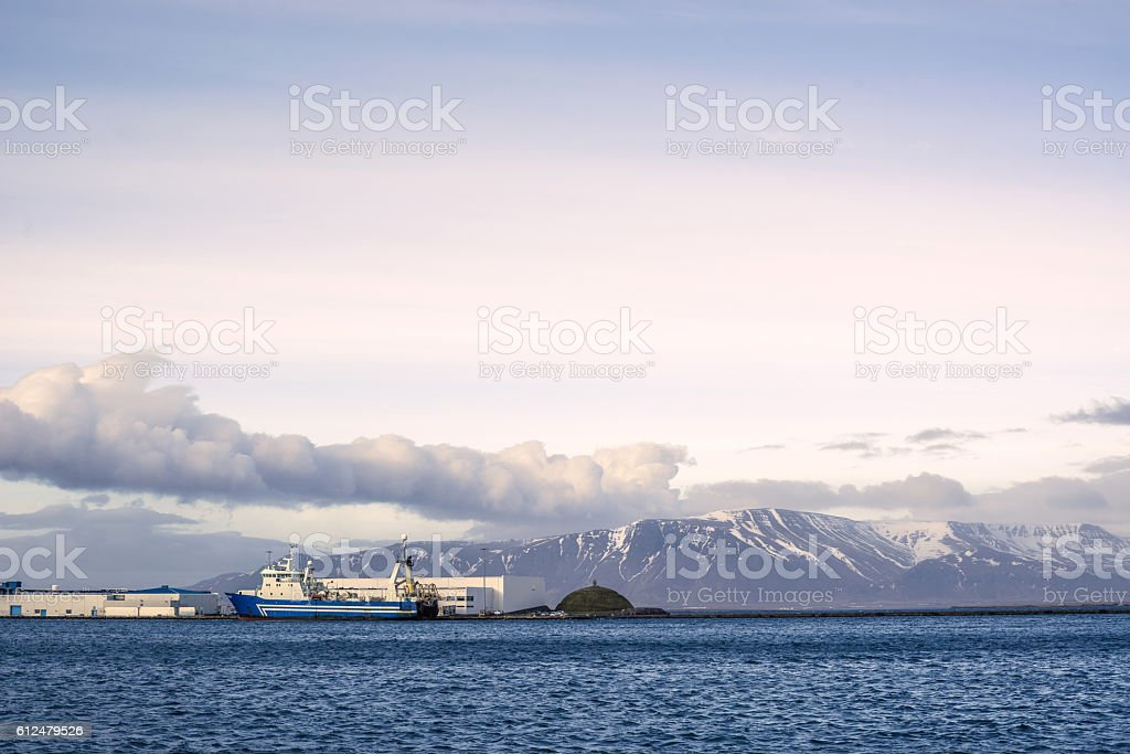 Ship by the harbor stock photo
