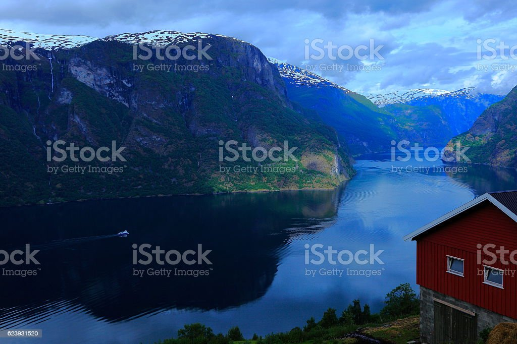 Ship crossing Aurlandsfjord sunset panorama, from above, Norway, Scandinavia stock photo