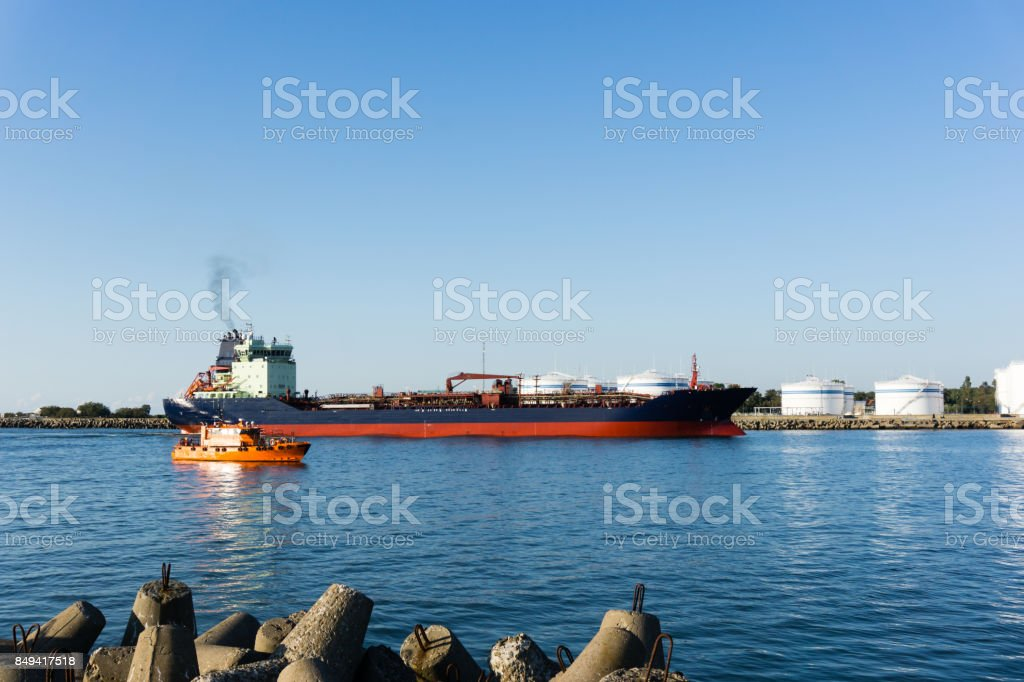 ship crossing sea gates at Baltic sea port Klaipeda, Lithuania stock photo