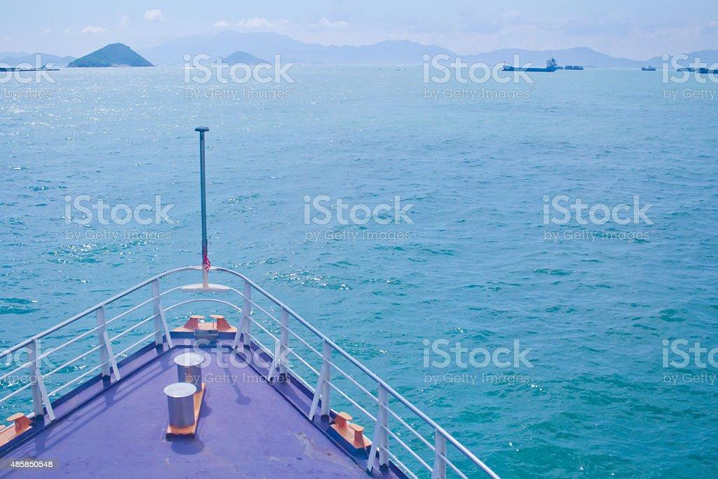 Ship cruising into open water stock photo