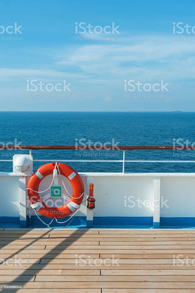 Ship deck, buoy and blue ocean stock photo