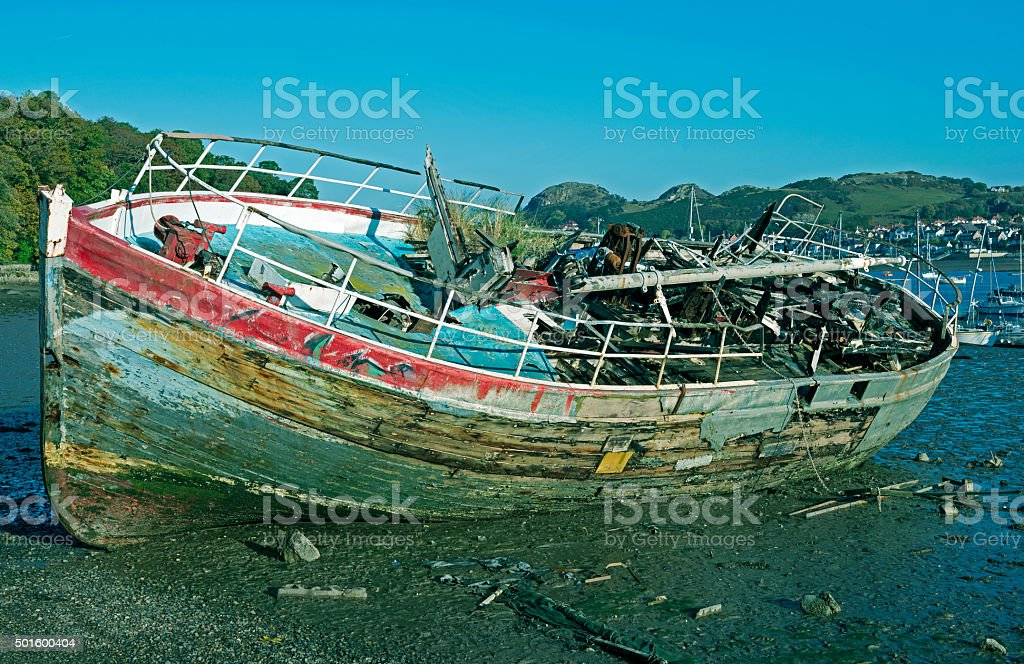 Ship destroyed by fire on beach at Conwy Wales stock photo
