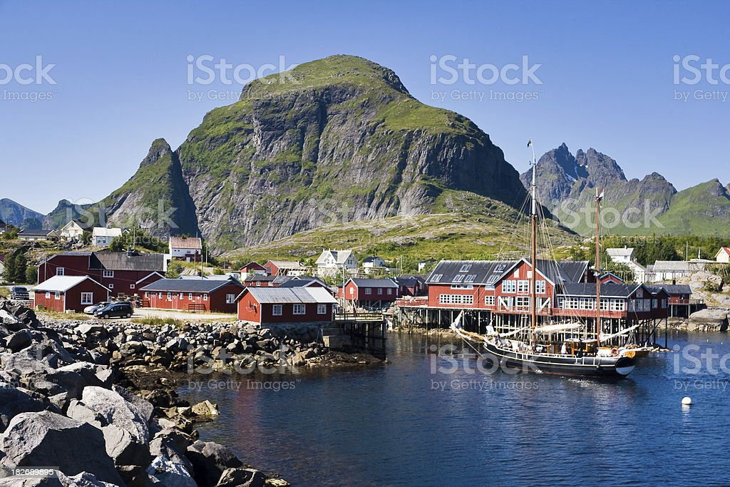 Ship Entering Harbour in Lofoten royalty-free stock photo