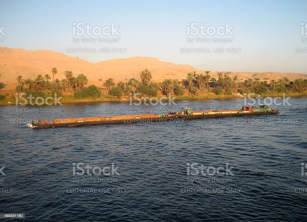 Ship freighter crossing the Nile River stock photo