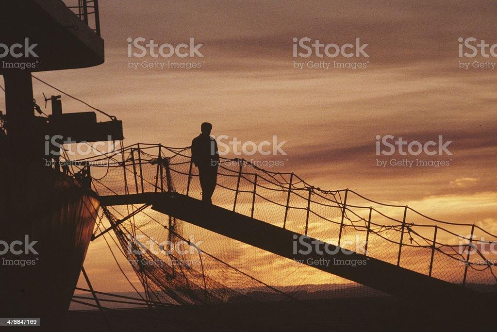 Ship gangplank at sunset stock photo