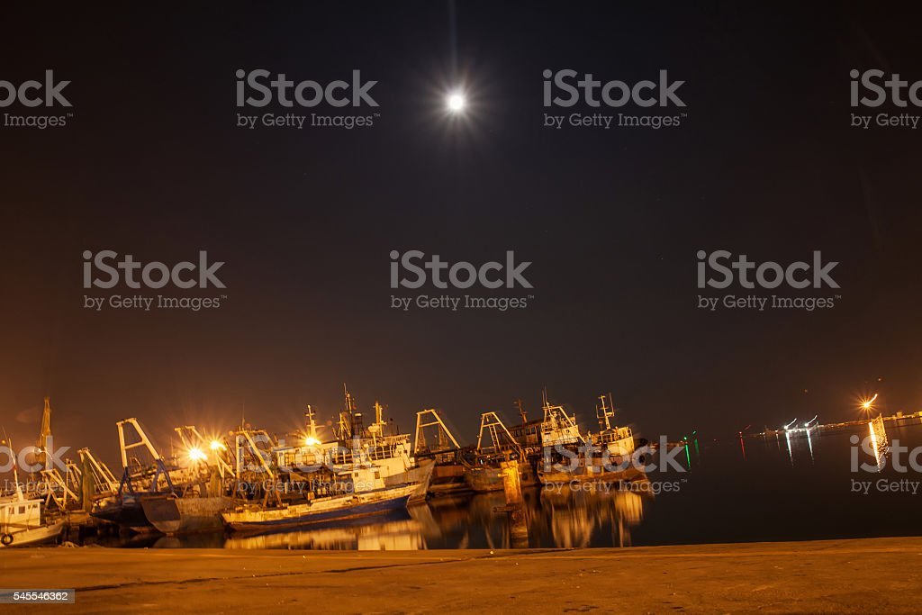 ship graveyard at night stock photo
