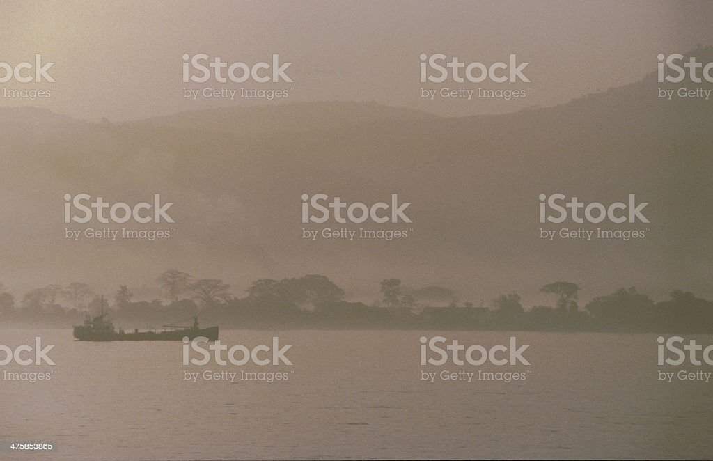 ship in front of coastline Sierra Leone stock photo