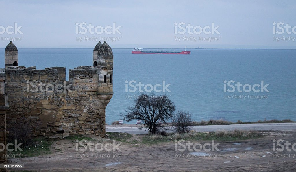 Ship in the Black Sea. Ancient fortress Ene-Calais stock photo