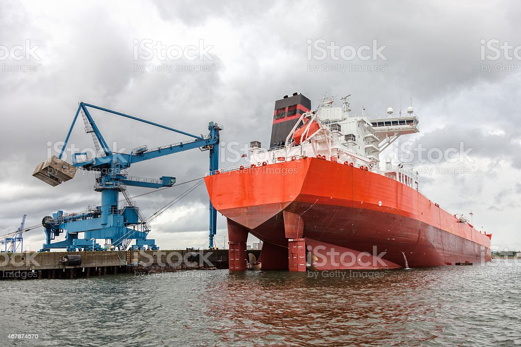 Ship in the harbor on a cloudy day stock photo