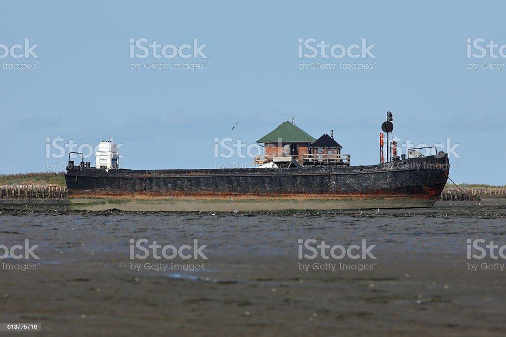 ship in the North Sea on a sandbank stock photo