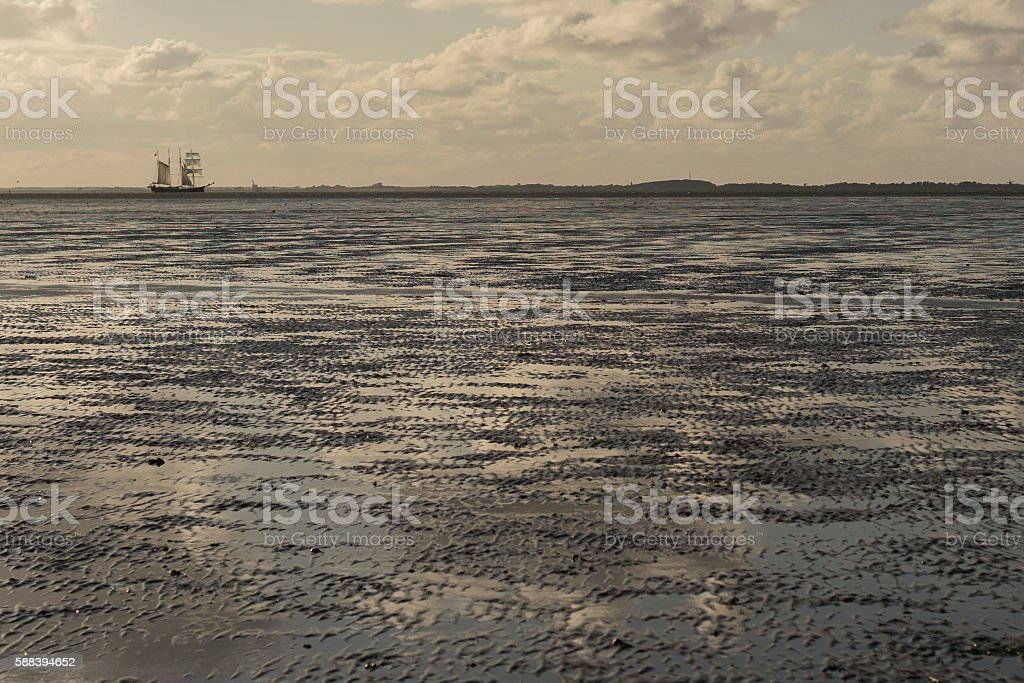 Ship is sailing thru the Waddenzee (the Netherlands) stock photo