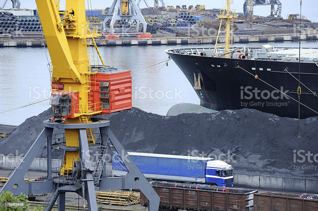 ship is unloaded at the port royalty-free stock photo