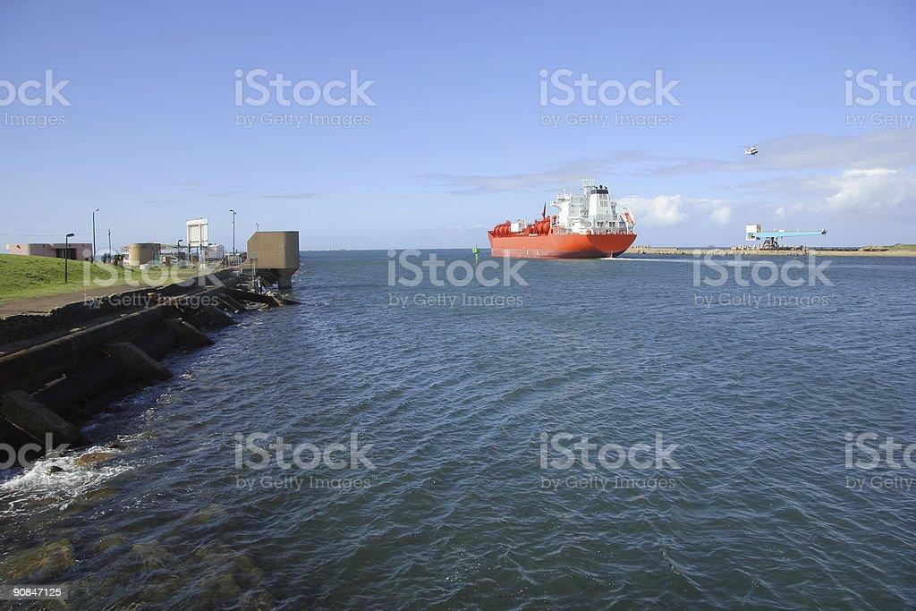 Ship leaving harbour stock photo