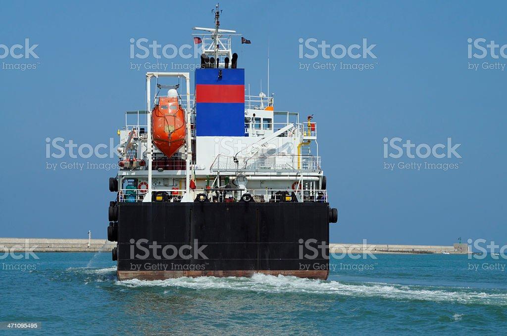 Ship leaving the harbor royalty-free stock photo