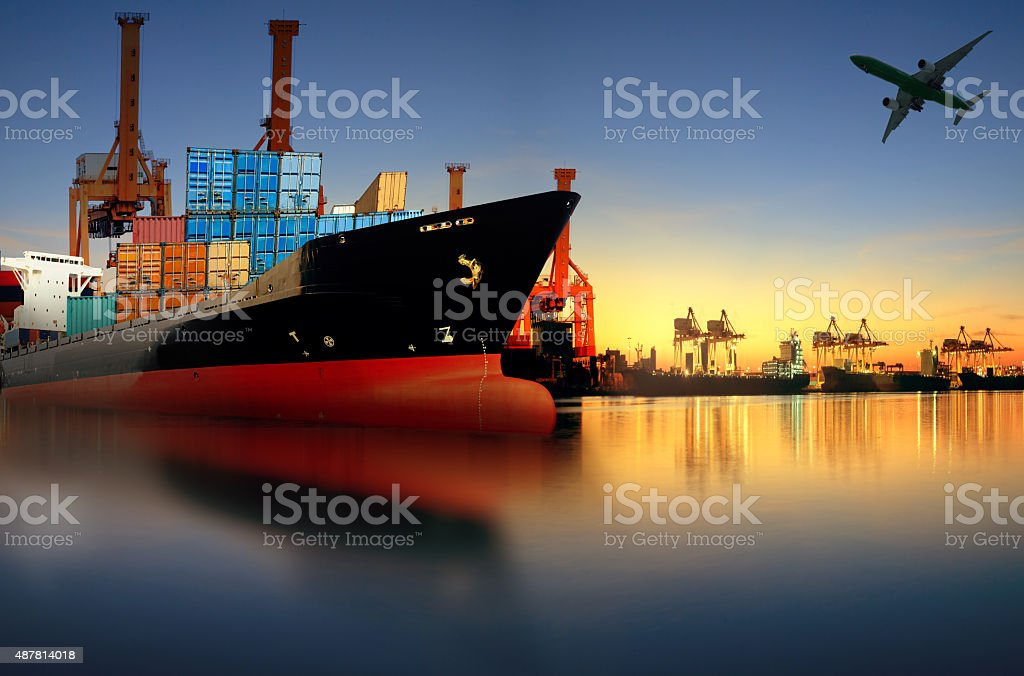 ship loading container in shipping port stock photo