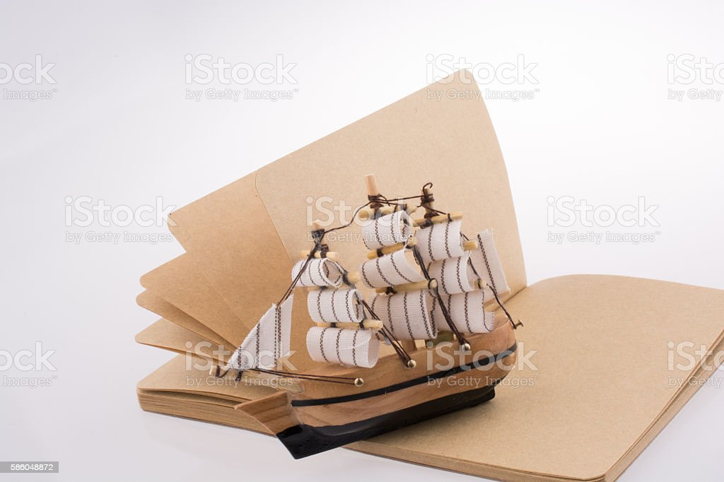 Ship on a notebook stock photo