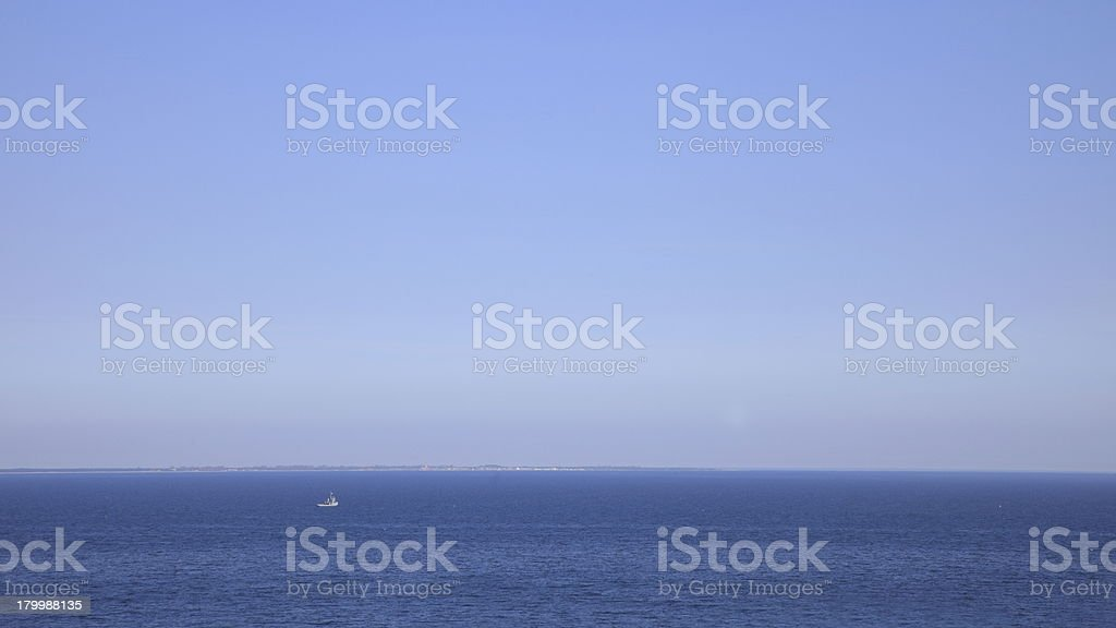 Ship on clear sea surface royalty-free stock photo