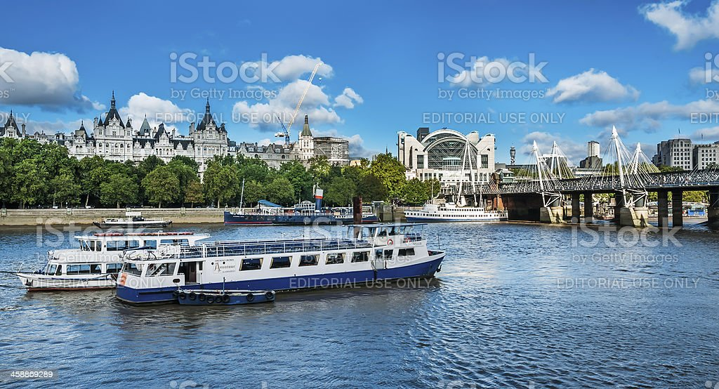 Ship on river Thames approaching Hungerford Bridge, London stock photo