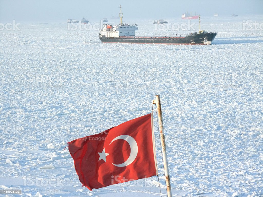Ship on the Frosted Sea and Turkish Flag stock photo