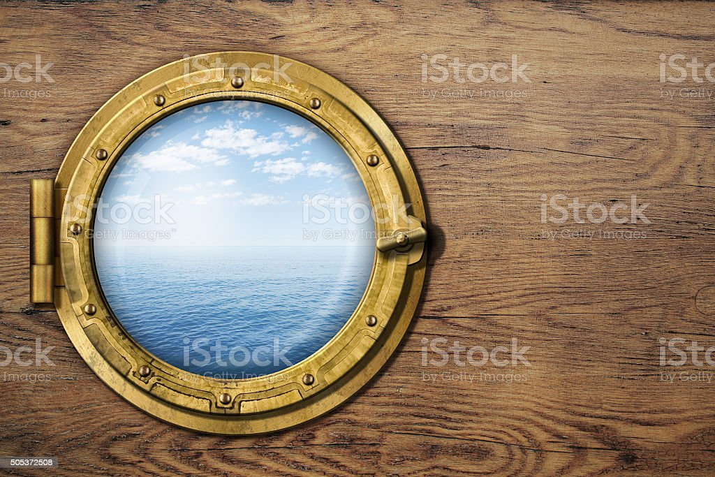 ship or boat porthole on wooden wall stock photo