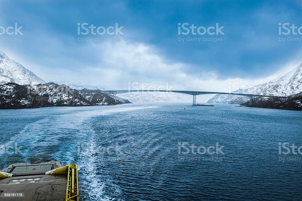 Ship passing under bridge stock photo