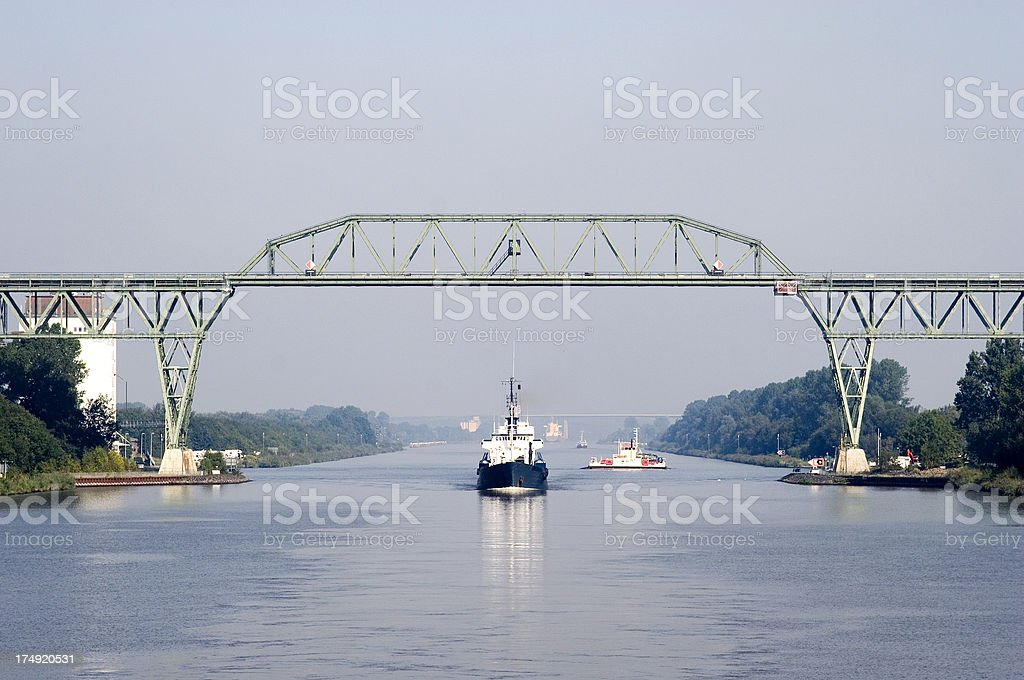 Ship passing under railway bridge, Kiel Canal, Germany stock photo