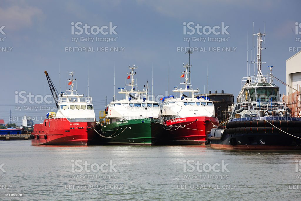 ship repair factory is operating on river stock photo