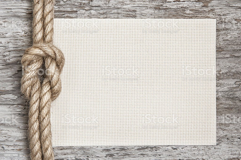 Ship rope, canvas and wood background royalty-free stock photo