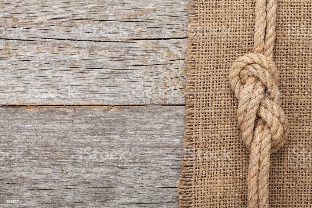 Ship rope on wooden texture background stock photo