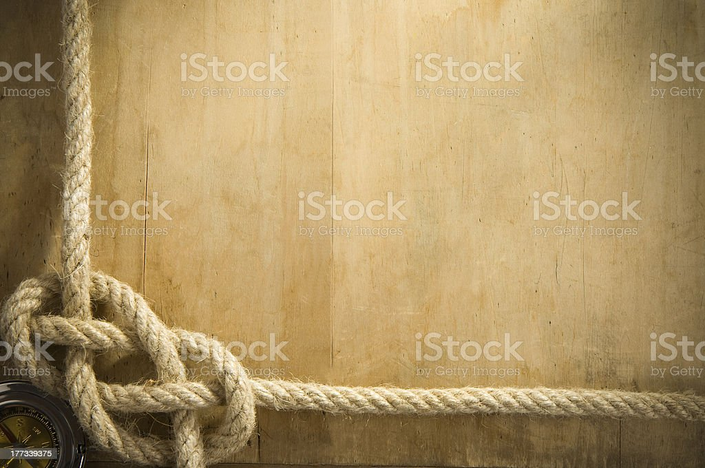 ship ropes and compass on old wood royalty-free stock photo