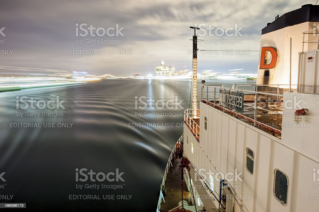 Ship Sailing Detroit Canal in Usa - Passing under bridge stock photo