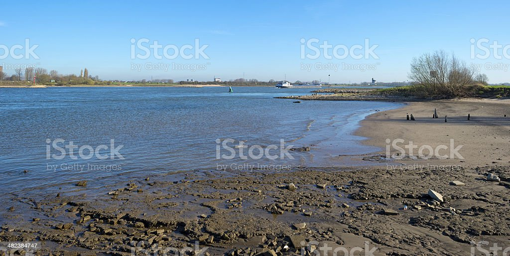 Ship sailing on a river under a clear sky stock photo
